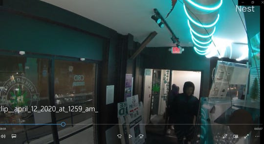 A photo taken from a video from Green Leaf Central's Nest camera shows several suspects breaking into the  Burlington business on April 12, 2020.