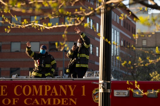 A Camden fire engine passes as a caravan of first responders parade by Cooper University Hospital in support of healthcare workers Monday, April 20, 2020 in Camden, N.J.