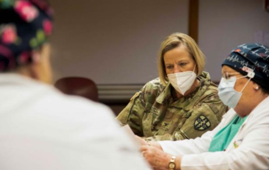 Army Col. Heidi Otis, a chief of nursing from Camp Parks, California, is briefed on hospital operations by Justine Murphy, director of perioperative services at Salem Medical Center in Salem.