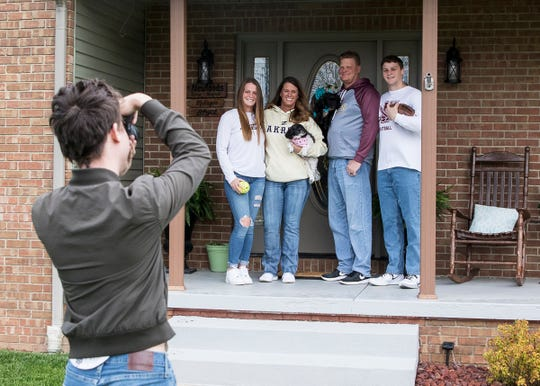 (L-R) Mikayla, Regina, Deric, and Bryce Newland pose for a family porch portrait taken by Paint Valley senior Spencer Immell on Wednesday, April 15, 2020. Bryce Newland, a senior for Paint Valley, was to play baseball before the announcement of school closure and the cancellation of spring sports.