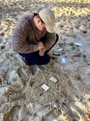 Zachary Reineke of the Surf Transfer team tests materials in sand.