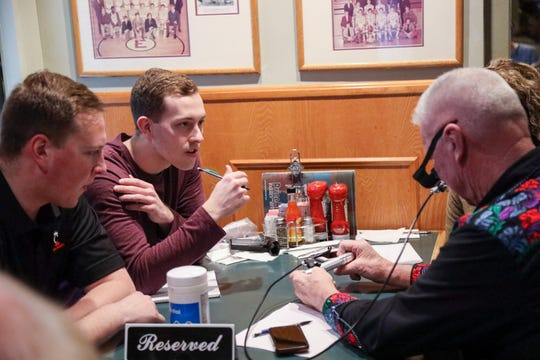 Engineering students from the University of Cincinnati meet with local veterans from VFW Post 10380 at Cincinnati's Price Hill Chili to test prototypes for the 'Drop Ease' project. The goal of the project is to come up with a means to easily administer needed eye drops to disabled veterans. The students have one prototype completed but were unable to complete the second prototype (a completely different design) due to COVID-19.  The prototype that was completed does work.
