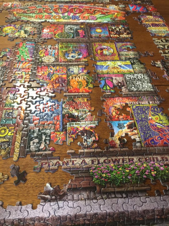 "Springbok puzzles feature uniquely shaped pieces of varying sizes. Pictured is ""Groovy Records."""