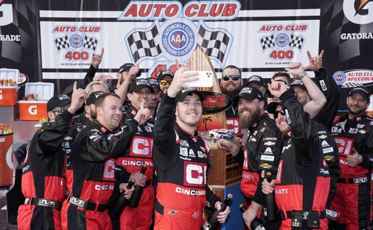 Alex Bowman and his crew take a selfie in victory lane after winning the Auto Club 400 in Fontana, California, in the Hendrick Motorsports No. 88 Cincinnati Inc. Chevrolet Camaro ZL1