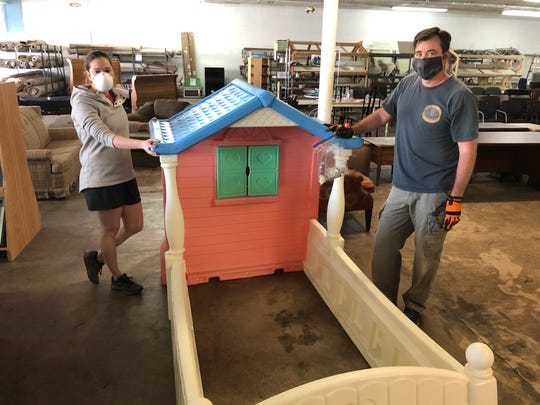 Volunteers Mary Jocelyn and Luke Dahlen help stage donated items for the Clarksville ReStore's new online platform. The ReStore serves as the main revenue source for Habitat for Humanity of Montgomery County. Customers can now visit shopclarksvillerestore.org to shop for items sold at the nonprofit retailer.