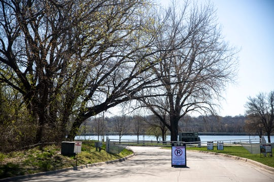The parking lots and roads at Gray's Lake have been closed to allow for social distancing at the park on Tuesday, April 21, 2020, in Des Moines.