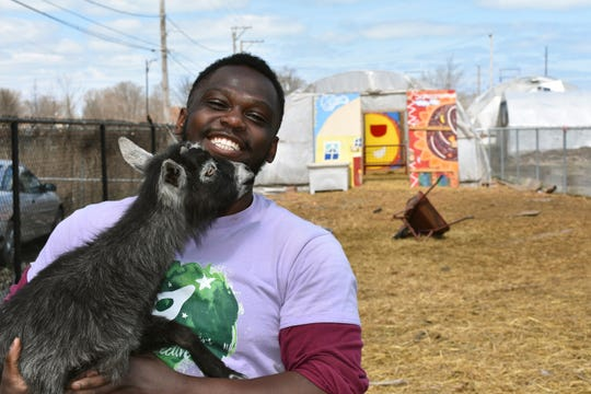 This April 10, 2020 photo shows Marshall Mitchell, Urban Farm Assistant at the Urban Growers Collective farm in Chicago.