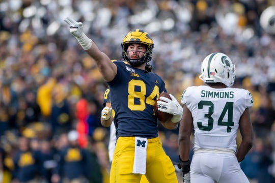 Michigan tight end Sean McKeon signals first down after completing a pass for 27 yards during the third quarter this past season against Michigan State.