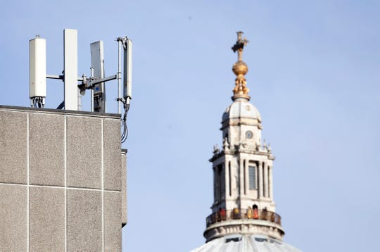 Mobile network phone masts are visible in front of St Paul's Cathedral in London.