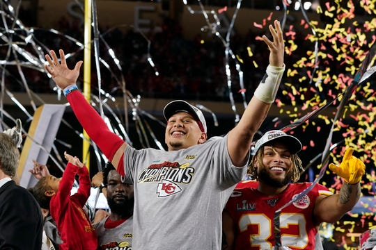 Chiefs quarterback Patrick Mahomes, left, is finally eligible to sign a contract extension this offseason.