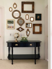A DIY project by Haneen Matt of Haneen's Haven: a gallery wall of vintage mirrors under a newly repainted console table.