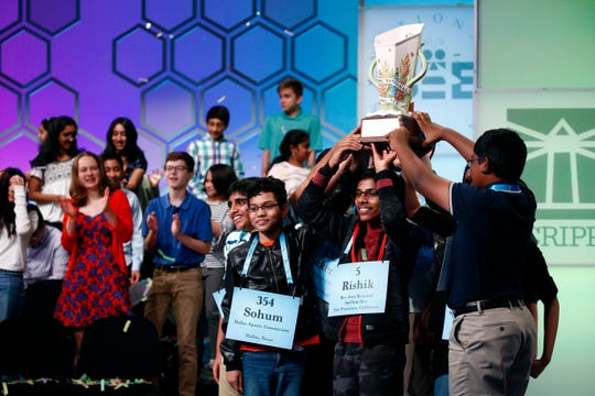 Eight co-champions celebrate after winning the Scripps National Spelling Bee, in Oxon Hill, Md. on May 31, 2019.