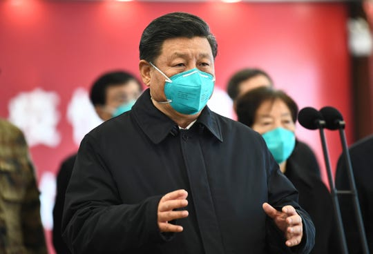 Chinese President Xi Jinping talks by video with patients and medical workers at the Huoshenshan Hospital in Wuhan in central China's Hubei Province on March 10, 2020.