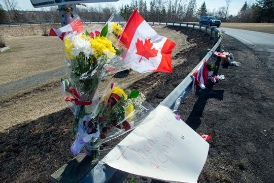 A memorial pays tribute to Royal Canadian Mounted Police Constable Heidi Stevenson, a mother of two and a 23-year veteran of the force, along the highway in Shubenacadie, Nova Scotia, on Tuesday.