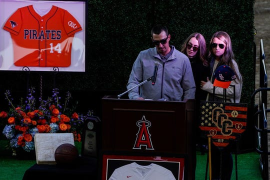 JJ Altobelli, accompanied by Lexi Altobelli and Carly Konigsfeld, speaks during a celebration of life ceremony at Angel Stadium on Feb. 10, 2020 in Anaheim, Calif. to honor the lives of John, Keri and Alyssa Altobelli, who were among the nine killed in a helicopter crash that also claimed the lives of Los Angeles Lakers legend Kobe Bryant and his daughter Gianna.