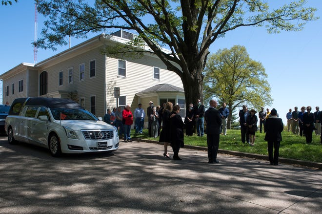 The funeral procession for John D. Engelbrecht passed by the WIKY offices where family and friends gathered on the lawn to say their goodbyes Tuesday afternoon, April 21, 2020.