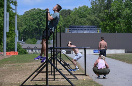 Clemson University student William Madden of Atlanta works out near Memorial Stadium in Clemson Tuesday. Madden said he would return home for the summer after staying in off-campus housing to finish online classes.