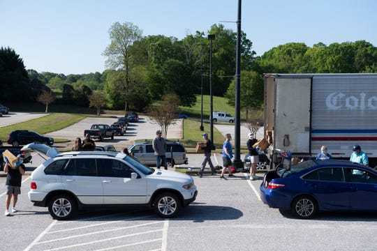House of Raeford Farms holds a chicken sale in the parking lot at Marathon Church Tuesday, April 21, 2020. The community chicken sales offer 40 lbs cases of chicken and a portion of the proceeds go to host venue.