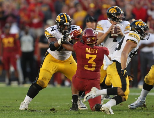 Tristan Wirfs (74) started four games at left tackle during his Iowa career; the Hawkeyes went 4-0 in those games, including a win in the 2017 Pinstripe Bowl and a big 2019 road win at Iowa State (pictured).