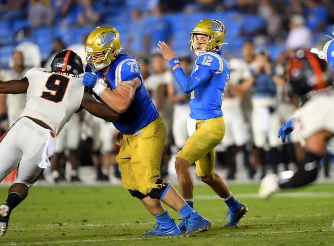 Oct 5, 2019; Pasadena, CA, USA; UCLA Bruins quarterback Austin Burton (12) looks downfield for an open receiver in the first half of the game against the Oregon State Beavers at the Rose Bowl.