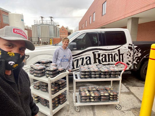 Area Pizza Ranch owner Brandon Pratt (left) delivering food to Mercy Hospital with Stacy Ringoen.
