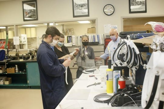 Methodist Orthotics & Prosthetics in Flowood, a division of Methodist Rehabilitation Center in Jackson, added making face shields to its normal job of building prosthetic limbs and braces. Staff involved in the project include, from left, Jesse Oaks, Pam Liberatore, Luly Johnson and director Chris Wallace