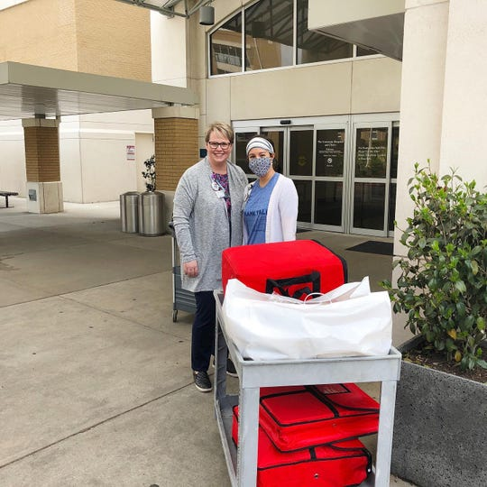 Aplos delivers lunches to health care workers in Jackson.