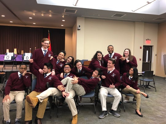 The Madison Academic High School academic decathlon team won the state competition for the seventeenth consecutive year in February. Here, they're pictured joking around at the state competition.
