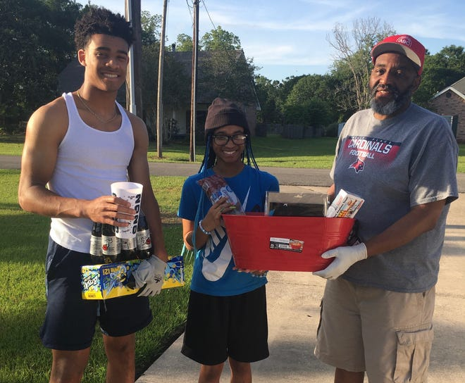 """People across Acadiana are providing gift baskets to high school seniors in an effort called """"Adopt A Senior"""" aimed at celebrating them during quarantine. Javian Willis, a senior at Catholic High in New Iberia, received this gift from Brian Blanchard and family."""