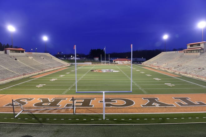 Mansfield's Arlin Field was one of several to light up Monday night in support of this year's graduating seniors.
