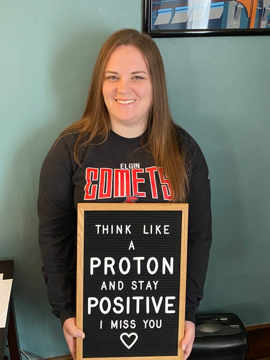 Elgin High School physical science teacher Jessie Keplinger combined a quick lesson with her message to students in the video.