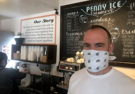"""Zachary Davis poses for a photo at The Penny Ice Creamery in Santa Cruz, Calif. """"We were feeling pretty good about where we were in the world. Now it's just all turned upside down,"""" said Davis, who had to lay off 70 workers."""