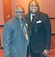 James E. Causey takes a photo with Mike Anderson after he was inducted into the Milwaukee Press Club Media Hall of Fame in 2017.