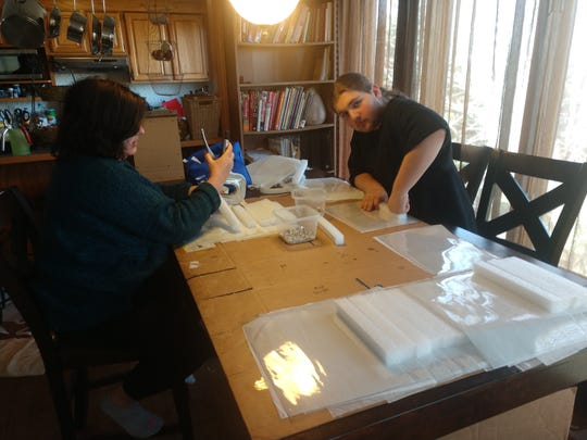 Deanne Stachowiak and her son, Mitchell, are making face shields for front-line workers during the coronavirus pandemic.