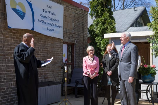Milwaukee Mayor Tom Barrett, right, takes the mayoral oath of office, as administered by Judge Joe Donald, left, on Tuesday, April 21, 2020, in Barrett's backyard. This is Barrett's fifth term as mayor.