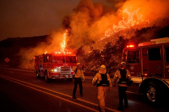 Firefighters battle the Cave Fire burn above Santa Barbara, Calif., Nov. 26, 2019. As the world marks the 50th anniversary of Earth Day, monumental challenges remain for environmentalists.
