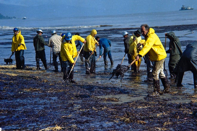 State forestry conservation crews gather up oil-soaked straw on a beach in Santa Barbara, Calif., on Feb. 6, 1969, Fifty years after the first Earth Day helped spur activism over air and water pollution, significant improvements are undeniable but monumental challenges remain.