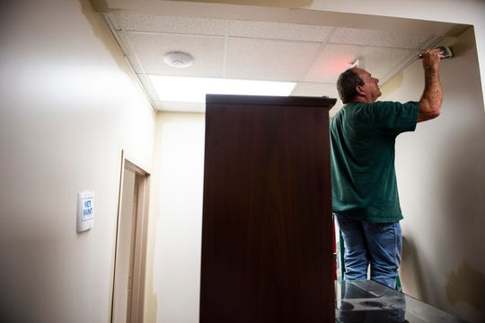 Crews paint the Autauga County Sheriff's office  in Prattville, Ala., on Tuesday, April 21, 2020.
