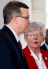 Governor Kay Ivey looks on as State Health Officer Dr. Scott Harris speaks at a coronavirus briefing in the state capitol building in Montgomery, Ala., on Tuesday April 21, 2020.