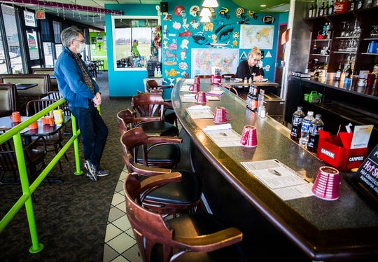 """A customer waits for a carry out order Tuesday, April 21, 2020. Merk's Family Dining announced via social media last week that it would close its doors for good after it was denied a small business stimulus loan while struggling amid coronavirus closures. Tim Merkel said the community has shown the business """"overwhelming"""" support since the post was made."""