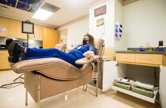 "Jennifer Zavodny donates convalescent plasma at Lee Memorial Hospital on Tuesday, April 21, 2020. Zavodny recovered from a milder case of COVID-19 and is the first lee county resident to donate plasma for the Mayo Clinic's study of ""convalescent plasma"" for a potential therapy for COVID-19 patients. She said If I can help just one patient get out of the hospital and be back home with their family, that is everything."" She is unsure how she contracted the disease. She is an employee with Lee Health but does not work with patients."
