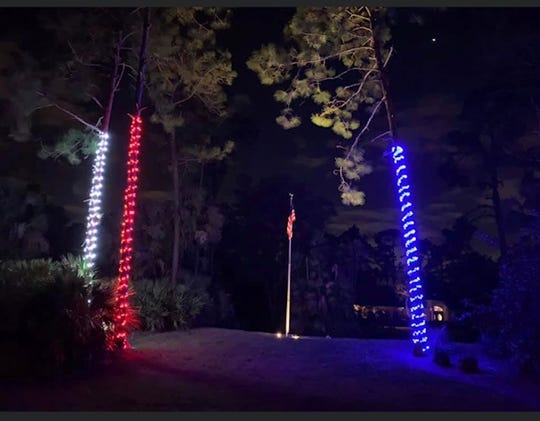 A yard lit by Trimmers Holiday Decor, Inc., in Golden Gate Estates.