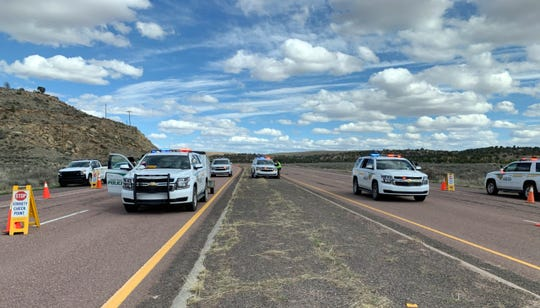 Navajo Police Department traffic enforcement team conduct a roadblock on April 18, 2020 on New Mexico Highway 264 near Tsé Bonito.