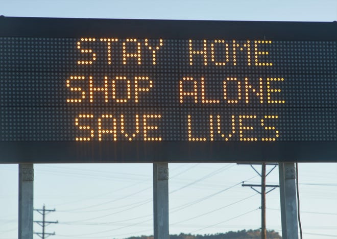 A New Mexico Department of Transportation electronic sign near Gallup displays the phrase state and tribal officials have been saying to the public as part of efforts to combat the coronavirus in communities.