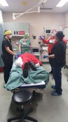 LCMC Emergency Room nursing staff train on repositioning a patient to a prone position while intubated. Studies have shown that alternating COVID-19 patients between a prone position and a supine position during ventilation is beneficial.