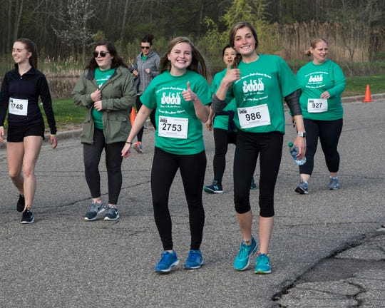 Participants stop for a photo during the 2018 SJ5K run.