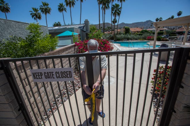Kevin McKelvie approaches a swimming pool at the Vista Canyon complex in Palm Springs on Tuesday, April 21, 2020. As temperatures rise for the season, Riverside County lifted a ban on shared-use pools Friday, but said only one person can use them at a time.