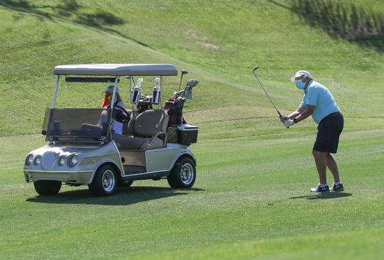 Golfers enjoy getting back on on the links at Indian Ridge Country Club in Palm Desert after the Riverside County of Public Health allowed golf courses to reopen, April 21, 2020.