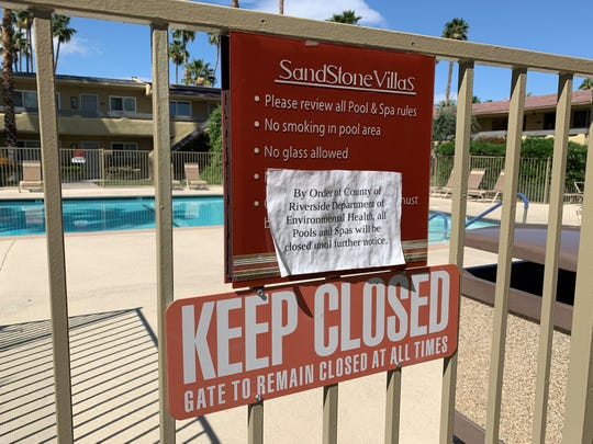 This April 20, 2020 photo shows a swimming pool closure at Sandstone Villas, a Palm Springs condominium complex. Riverside County health officials ordered public and community pools to shut down to prevent the spread of coronavirus.