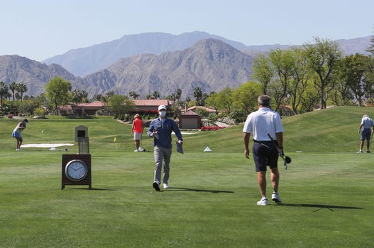 Golfers use the driving range in a limited capacity at Indian Ridge Country Club in Palm Desert, April 21, 2020.